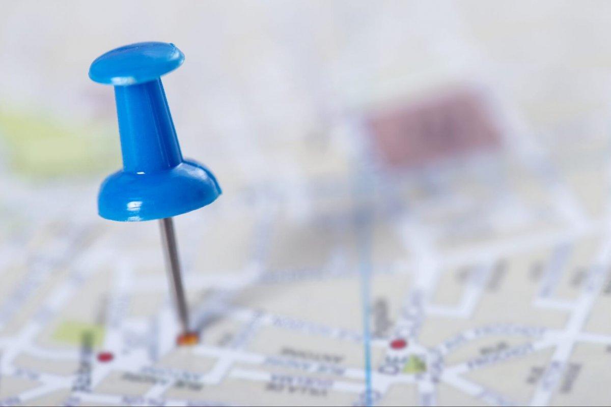 Pushpin marking a location on a city map.